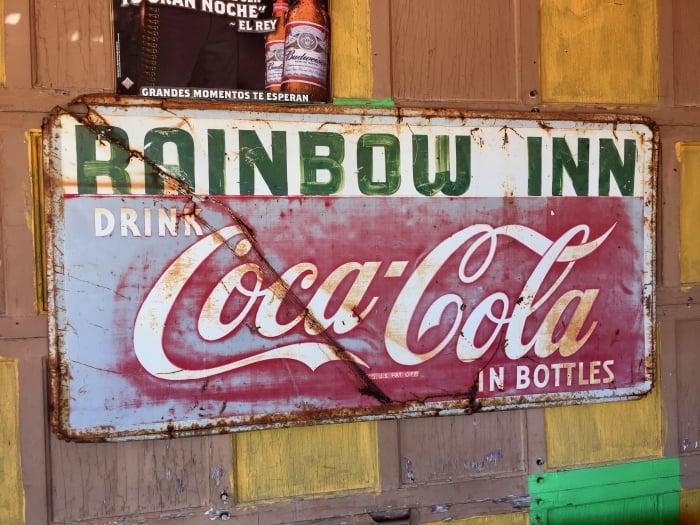 Rainbow Inn Vintage Sign