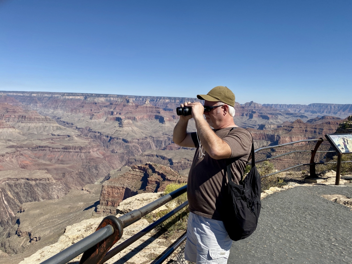 Howard looking at the Grand Canyon with binoculars